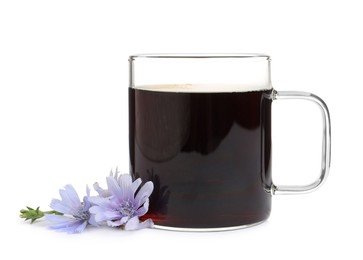 Glass cup of delicious chicory drink and flowers on white background