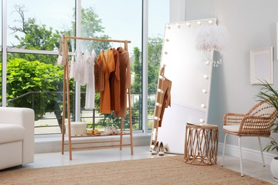 Dressing room interior with clothing rack and comfortable furniture