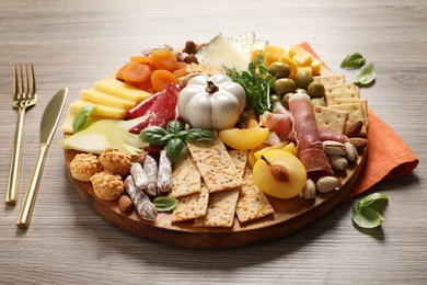 Different tasty appetizers served on wooden table