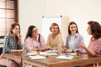 Female professional business team working in office. Women power concept