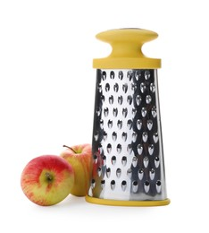 Stainless steel grater and fresh apples on white background