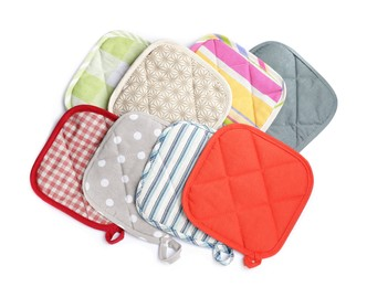 Oven potholders for hot dishes on white background, top view