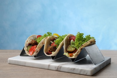 Delicious fresh vegan tacos served on wooden table