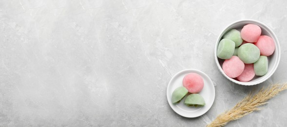 Delicious mochi and pampas grass on light grey marble table, flat lay with space for text. Traditional Japanese dessert