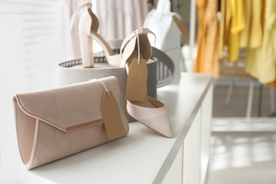 Women's bag and high heel shoes in modern clothing boutique