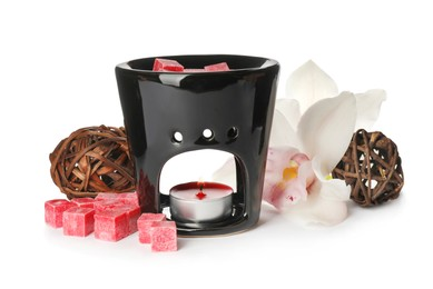 Stylish aroma lamp with essential wax cubes and flower on white background