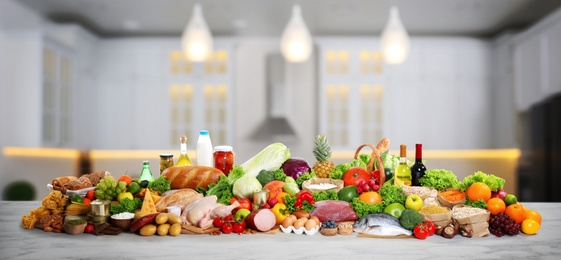 Different products on wooden table in kitchen. Healthy food and balanced diet