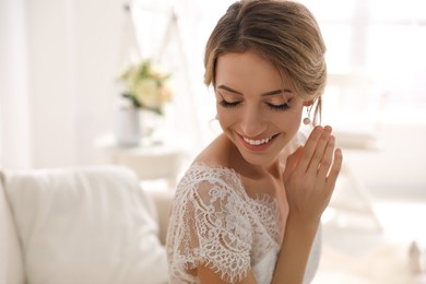 Gorgeous bride in beautiful wedding dress indoors. Space for text