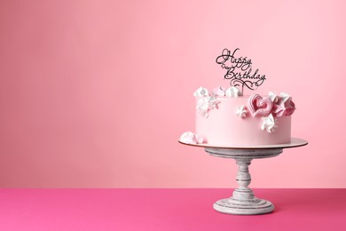 Beautifully decorated birthday cake on pink background, space for text