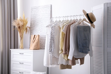 Dressing room interior with stylish white furniture