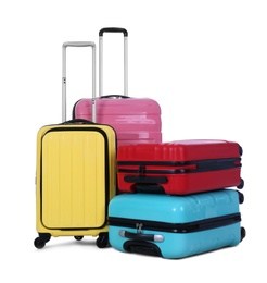 Stylish suitcases packed for travel on white background. Summer vacation