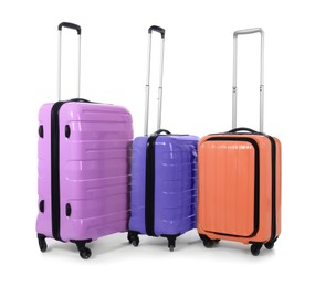 Stylish suitcases packed for travel on white background