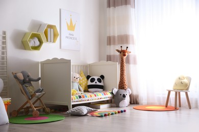 Baby room interior with stylish furniture and toys