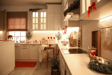 Small Christmas trees and festive decor in kitchen