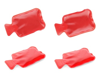 Set with red rubber hot water bottles on white background