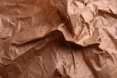 Texture of wrinkled kraft paper bag as background, closeup