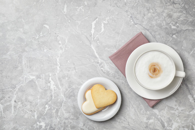 Flat lay composition with coffee on grey marble table, space for text. Tasty breakfast