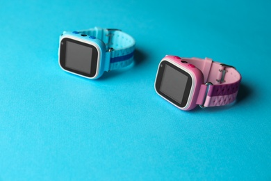 Modern trendy smart watches for kids on light blue background