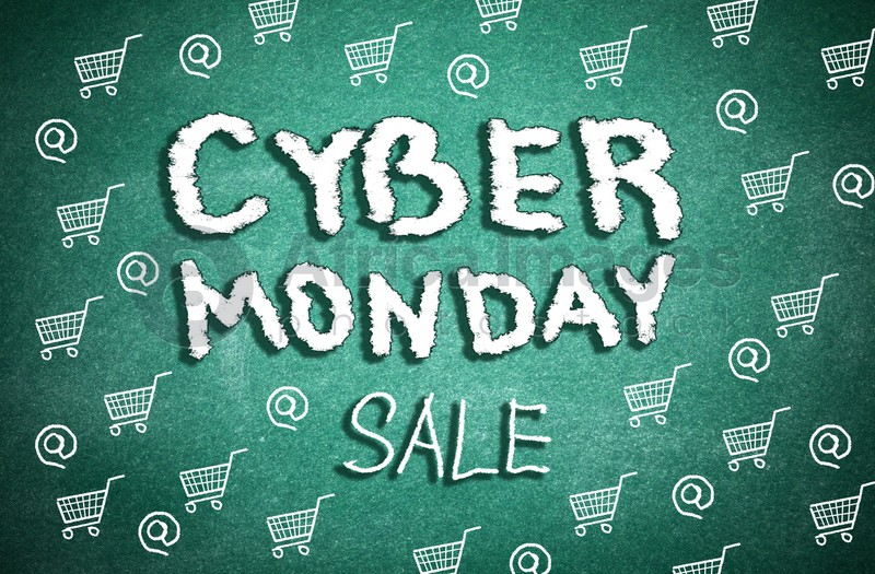 Text Cyber Monday Sale and pictures of small shopping carts on green chalkboard