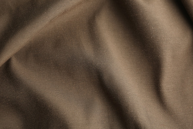 Texture of beautiful brown fabric as background, closeup