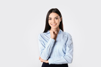 Portrait of young businesswoman on white background
