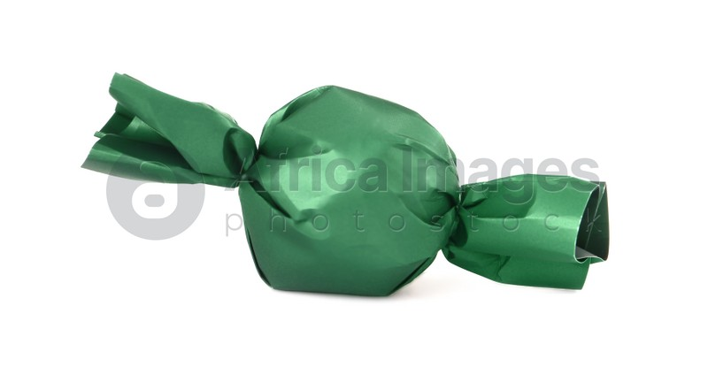 Delicious candy in dark green wrapper isolated on white