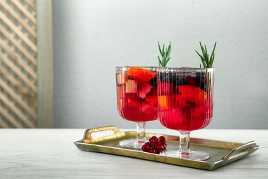 Glasses of Red Sangria on white wooden table