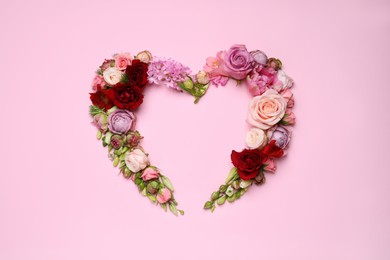 Beautiful heart shaped floral composition on pink background, flat lay