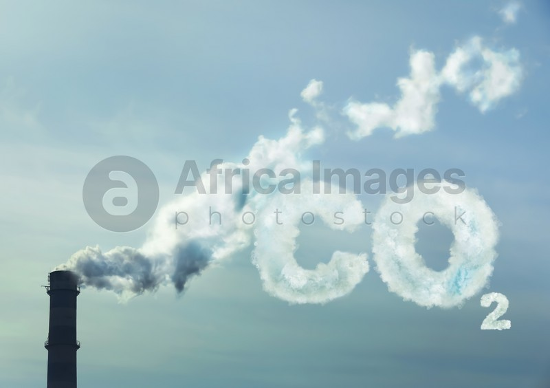 Inscription CO2 made of smoke. Polluting air from industrial chimney outdoors