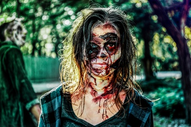 Scary zombies with bloody faces outdoors. Halloween monster