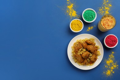 Traditional Indian food and color powders on blue background, flat lay with space for text. Holi festival celebration