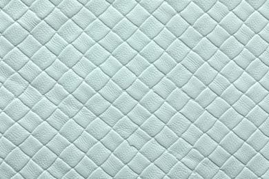 Texture of light blue leather as background, closeup