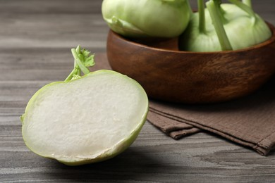 Whole and cut kohlrabi plants on wooden table