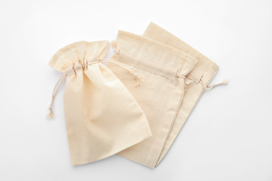 Cotton eco bags isolated on white, top view