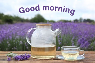 Tasty herbal tea and fresh flowers on wooden table in lavender field. Good morning