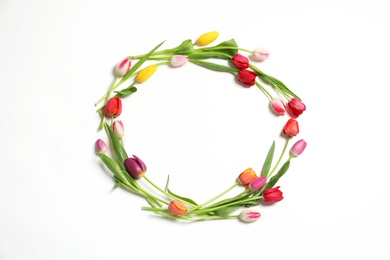 Frame made with beautiful tulip flowers on white background, top view. Space for text
