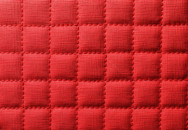 Texture of red leather as background, closeup