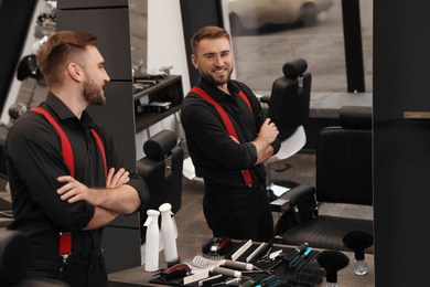Young business owner in his barber shop