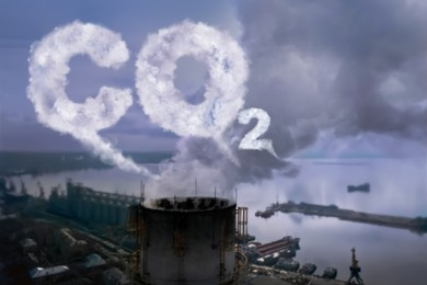 Inscription CO2 made of smoke. Aerial view of industrial factory