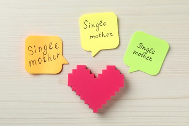 Heart and text Single mother on white wooden background, flat lay