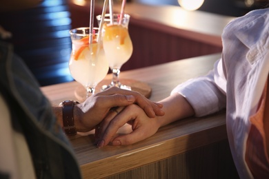 Man and woman flirting with each other in bar, closeup