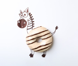 Funny zebra made with donut on white background, top view