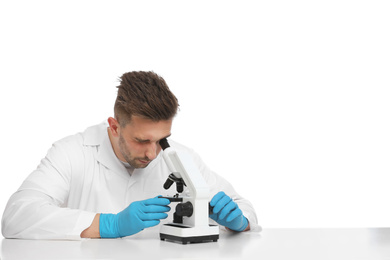 Scientist using modern microscope at table isolated on white. Medical research