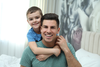 Dad and son spending time together at home. Happy Father's Day