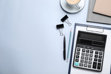 Calculator and stationery on light background, flat lay. Space for text