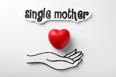 Hand with heart and text Single Mother on white background, flat lay