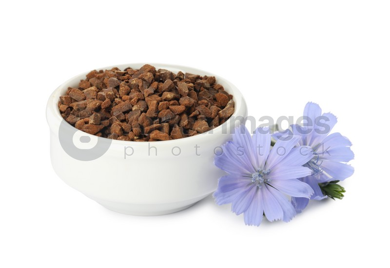 Bowl of chicory granules and flowers on white background