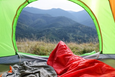 Sleeping bags in camping tent outdoors, view from inside