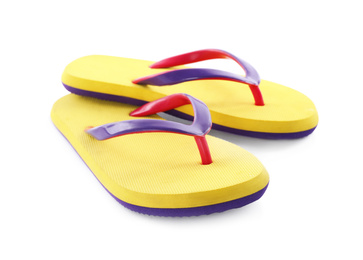 Pair of stylish yellow flip flops isolated on white. Beach object