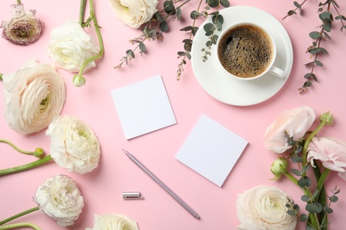 Flat lay composition with spring ranunculus flowers and cards on color background. Space for text